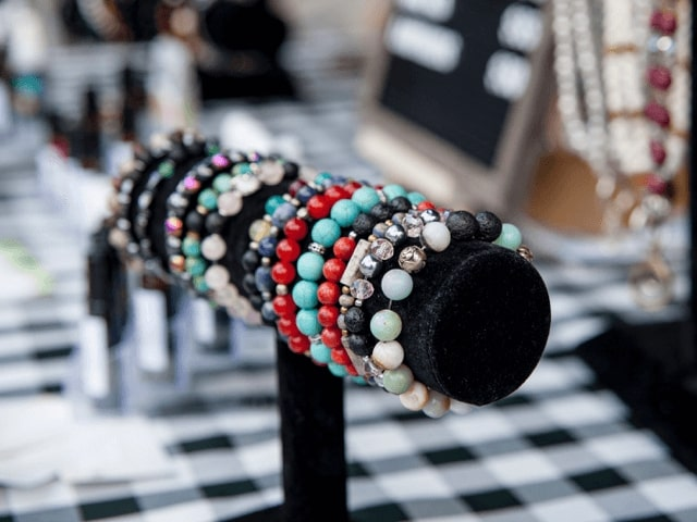 Bracelets on display at an artisan vendor's stall.