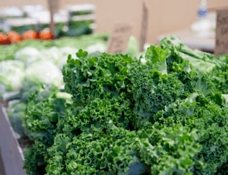 Kale displayed at a Kitchener Market vendors' booth.