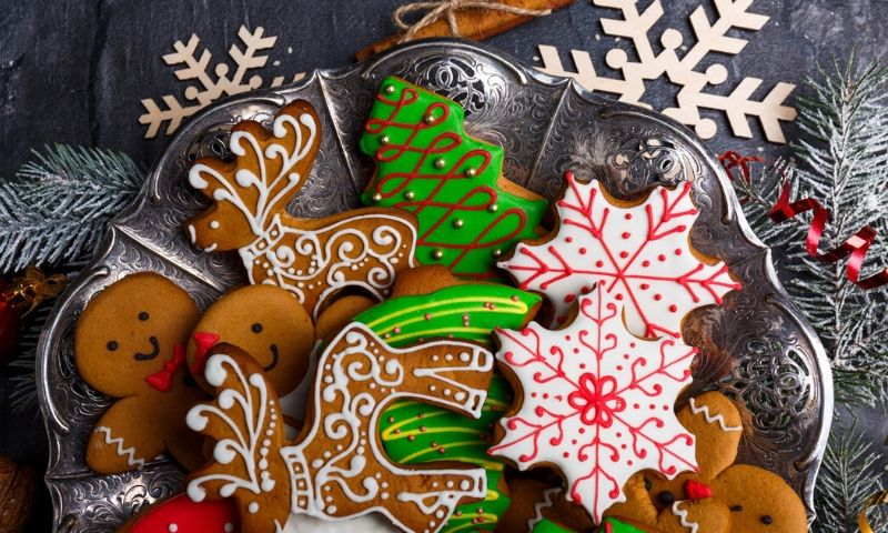 Decorated Christmas cookies on a plate.